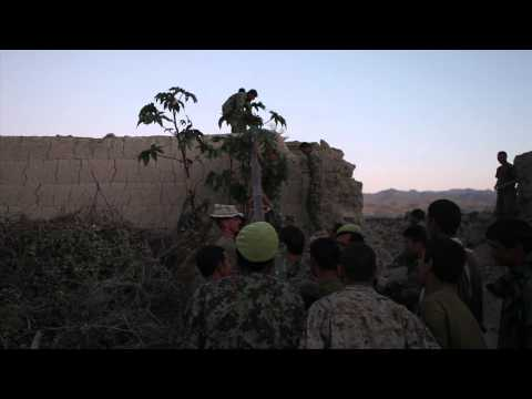 ANA Soldiers Raise Flag at New Patrol Base