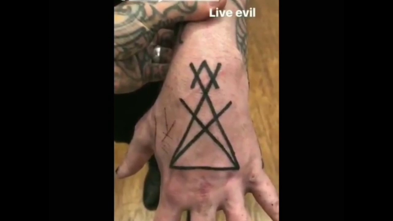 Marilyn manson 39 s new tattoo symbol for lucifer say 10 for Tattoos that say something different upside down