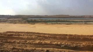 قناة السويس الجديدة : مشهد للقناة الجديدة  من السيارة بالقطاع الشمالى