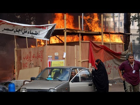 Bloodshed in Cairo as pro-Morsi camps cleared - video report