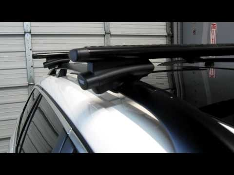 2013 Volkswagen Jetta Sportwagen with Thule 450R Crossroad AeroBlade Roof Rack by Rack Outfitters