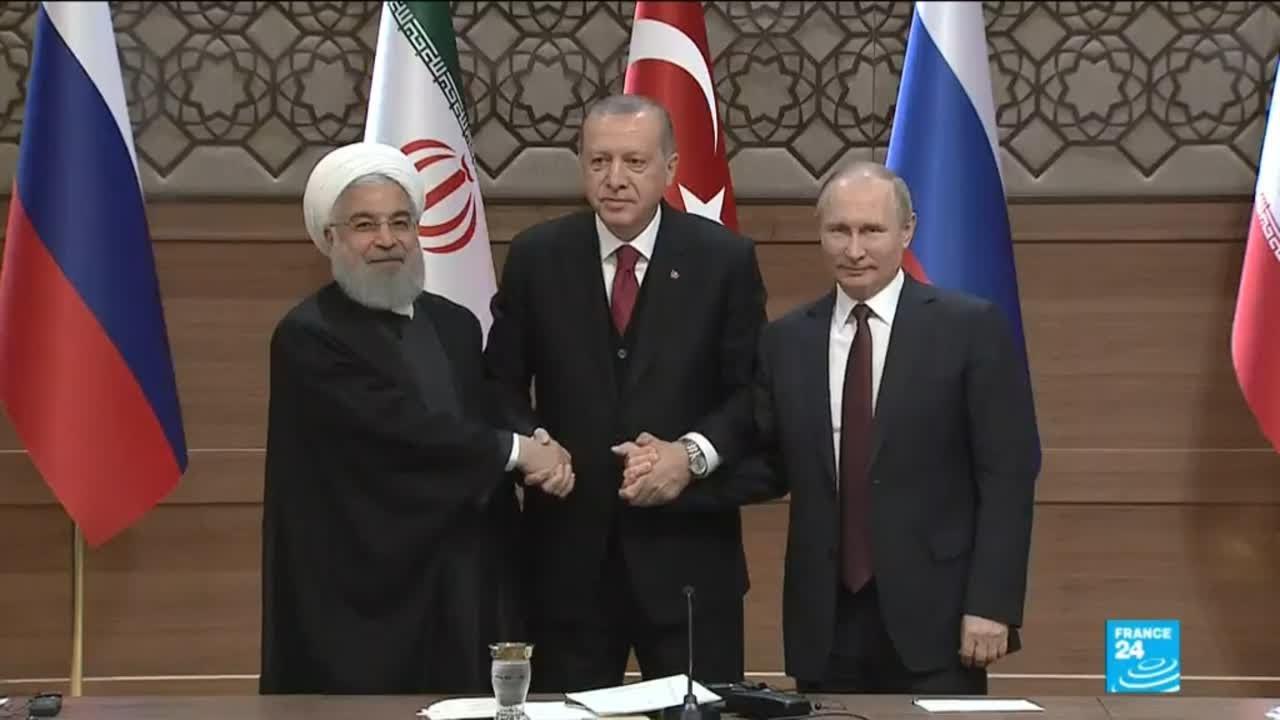 Rouhani (Iran), Erdogan (Turki), dan Putin (Rusia), saat melakukan pertemuan di ibukota Turki, Ankara. (gambar dari: https://www.youtube.com/watch?v=gFwEeEFe43Q)