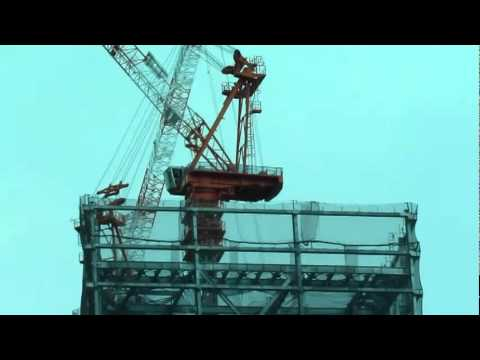 High-rise construction crane sways during earthquake aftershocks