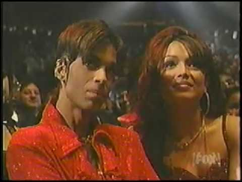 Prince Receives the 1998 Essence Award Highlights and ... Mayte Garcia Nelson