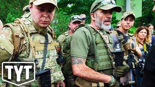 Trump Caravan Conspiracies Encourage Armed Civilians