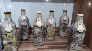 Decorated marble effect bottles with decoupage