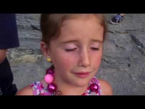 Little girl almost falls off the side of a cliff!