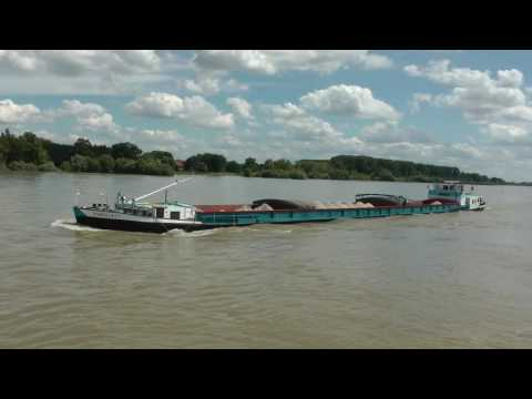 commercial cargo ships on the Rhine River in Germany
