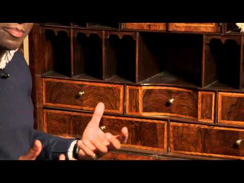 Early 18th century walnut double domed bureau cabinet