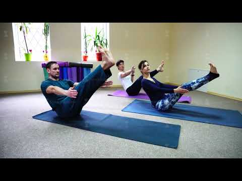 Three young people doing yoga at fitness studio
