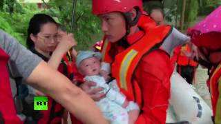 Evacuation of dozens of people from flooded village in south China
