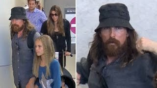 A Scraggly Christian Bale Hides Behind Beard, Dodging Affleck Batman Questions
