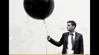 Play Man In A Garage (Bonobo Remix, Feat. John Matthias)