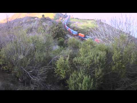Union Pacific Double Stack Container Train over looking the Craquinez  Strait  ContourHD 1080p HD