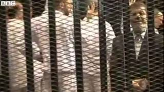 Egyptian TV shows footage of Mohammed Morsi in court Thumbnail