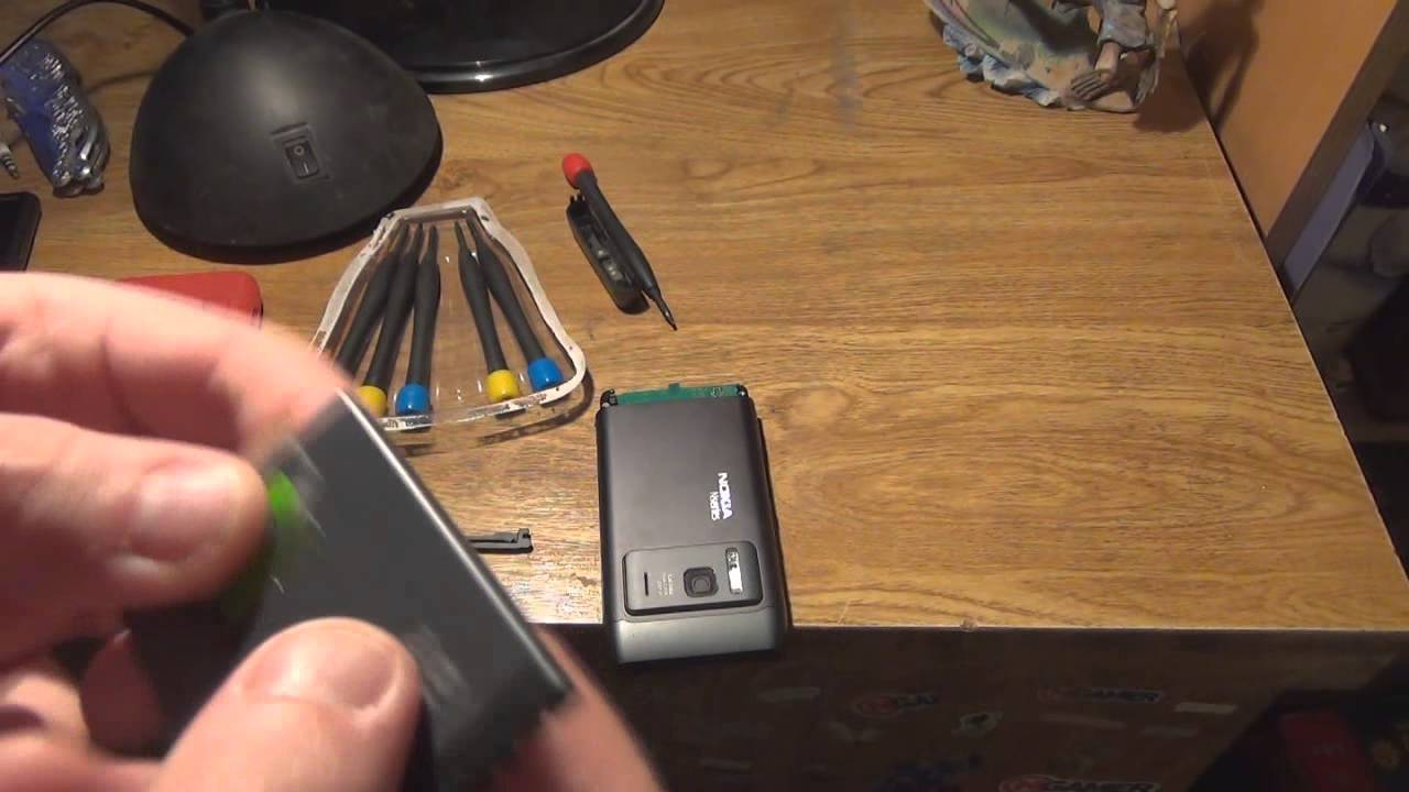 how to change battery on nokia n8