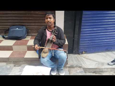 A roadside street artist sings a beautiful nepali song.