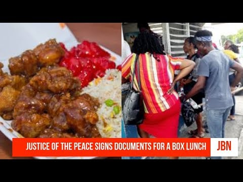 Justice Of The Peace Signs Documents For A Box Lunch/JBN