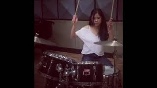 Kisses Delavin playing Drums and Guitar