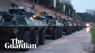 China releases video showing troop carriers moving to Hong Kong border