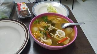 Cooking Thai food Squid spicy soup (Tom Yum Pla muk)