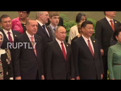 China: Putin and Xi Jinping join world leaders for Belt and Road Forum family photo
