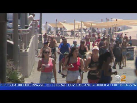 'This Is Amazing': Beach-Goers Head To Huntington Beach To Beat The Heat