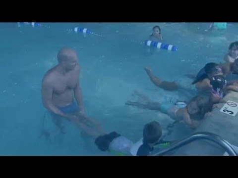 Olympic Gold Medalist Rowdy Gaines Teaches Beach Kids to Swim