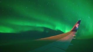 Watch as plane flies through Southern Lights