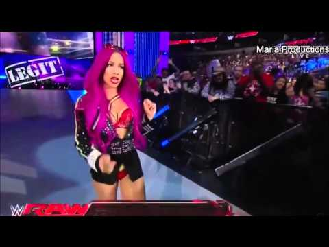 Sasha Banks enters the arena with AJ Styles's theme song