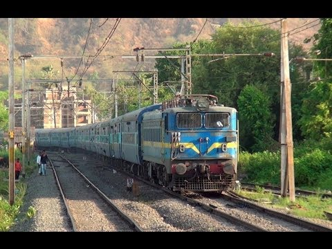 Full Blue Train - Pune Indore Express behind CNB WAG-7 Locomotive accelerating at Neral, India