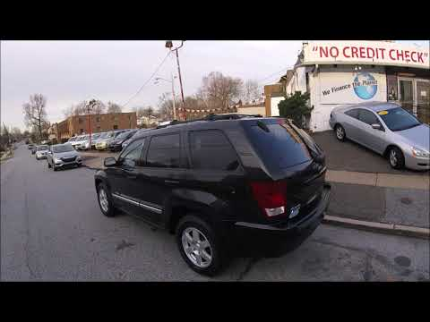 2010 Black /Tan Jeep Grand Cherokee Laredo 4WD (1J4PR4GKXAC) with an 3.7L V6 SOHC 12V engine, 5-Speed Automatic transmission, located at 577 Chester Pike, Prospect Park, PA, 19076, (610) 237-1015, 39.886154, -75.302338 - Photo #0
