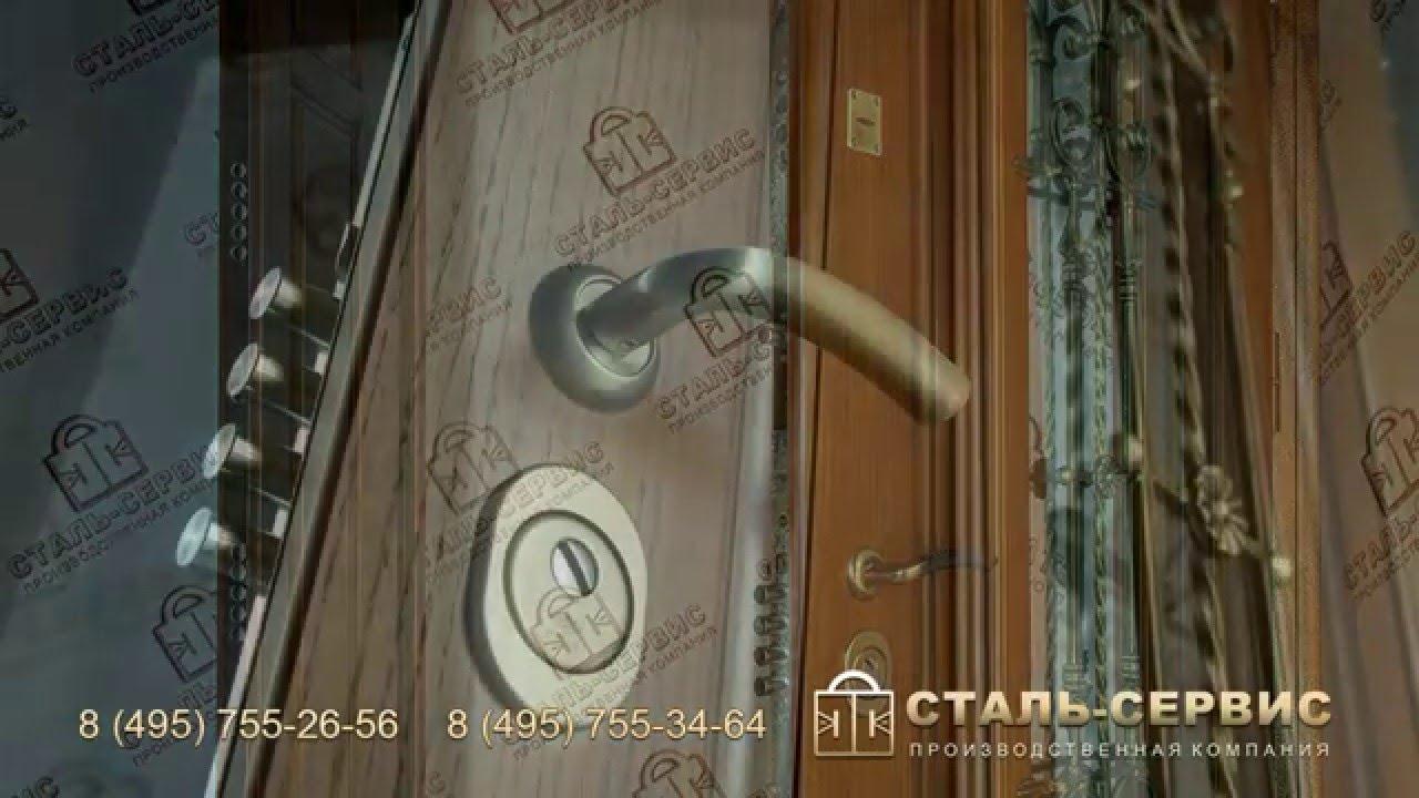 завод со стеклом и кованным элементом металлические двери