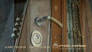 Парадная металлическая дверь со стеклом и ковкой. Производитель - завод