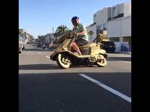 Gold Scooter Drifts in Slow Motion