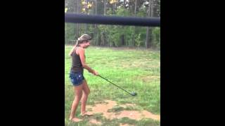 Take 2 of my girlfriend hitting a golf ball