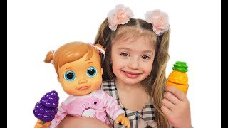 Dominika with a doll play with fruits