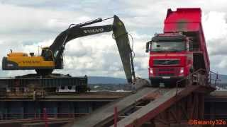 Ship Mounted Volvo EC360C & Dump Trucks Tipping Loads