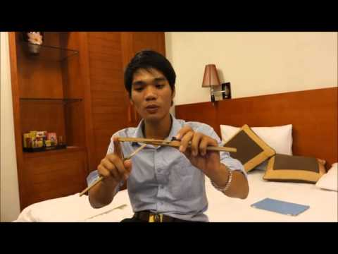 NGUYEN DINH MAO explains his method of making a bamboo jew's harp, sept 28 2015, Hanoi