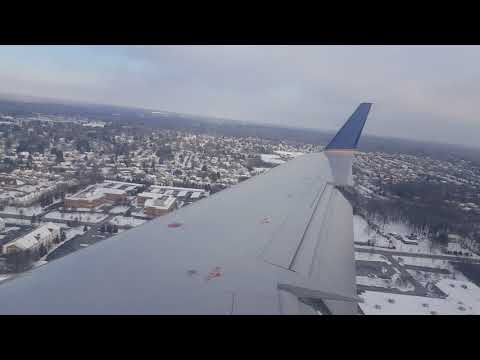 United Airlines Bombardier CRJ-200 wingview landing in Columbus, Ohio on a winter's day