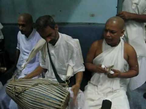 Pathbari devotees perform Arati and kirtan on the Train