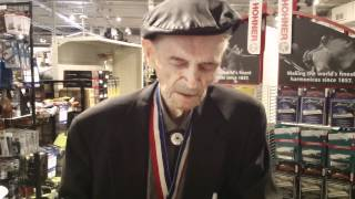97 Year Old Ernest Mattson buys a harmonica at Groth Music