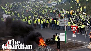 'It's Macron's fault': parts of France in gridlock as thousands protest fuel tax hikes