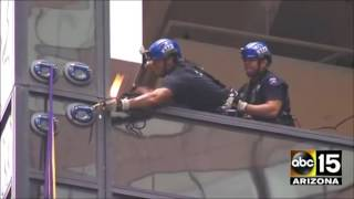 GOT HIM! Watch Police aggressively capture Climber Scaling Trump Tower - OUCH!
