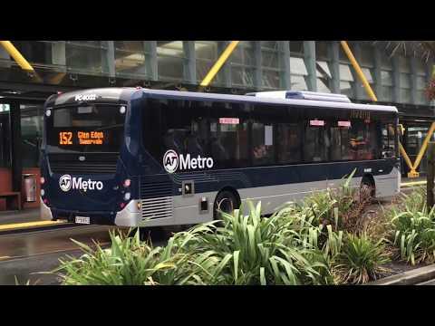 AT Metro Buses at New Lynn Station + AT Train stopped on tracks (short clip)