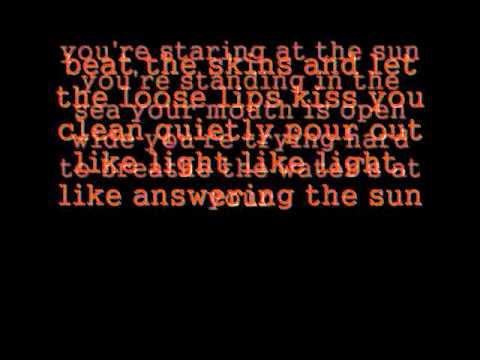 Staring at the Sun - TV On the Radio (lyrics)