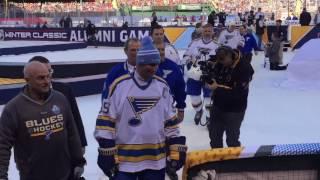 Wayne Gretzky handing off his stick in the 2017 Winter Classic Alumni Hockey Game at Busch Stadium