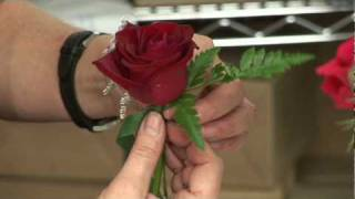 Wedding Flowers & Floral Arrangements : How to Make a Boutonniere for a Wedding or a Prom(To make a boutonniere for a wedding or prom, choose a flower, remove the greenery, wrap the flower with floral tape, add a filler flower and add any other ..., 2009-01-26T19:07:43.000Z)