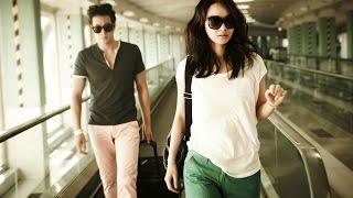 Photos of So Ji Sub and Shin Min Ah at the airport