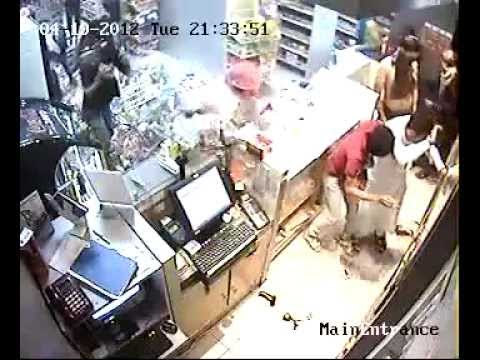 Thugs backed up by police attacking Jawad 24 Hours supermarket - From different angle